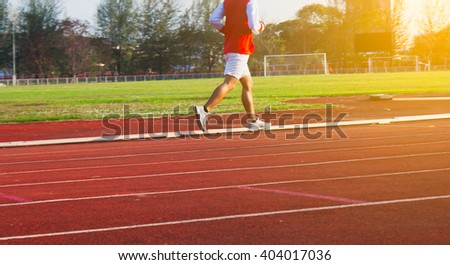 Healthy Living Concept. Man running in field Motion blur, Sunset time.
