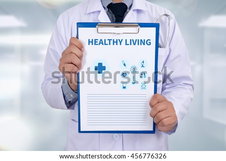 HEALTHY LIVING Portrait of a doctor writing a prescription