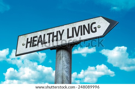 Healthy Living sign with sky background - stock photo