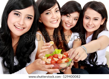 healthy lovely group of woman having fresh salad together - stock photo