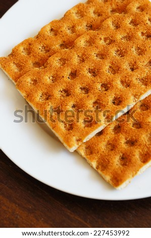 Healthy low-calorie crisp bread on a white plate