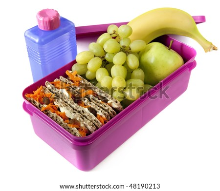 Healthy lunch in a bright pink lunch box. - stock photo