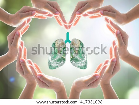 Healthy lung shape world design logo concept idea with love heart shape symbolic sign of women human hands on blur green natural clean air greenery background: Element of this image furnished by NASA - stock photo