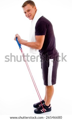 healthy man stretching with exercise rope against white background - stock photo