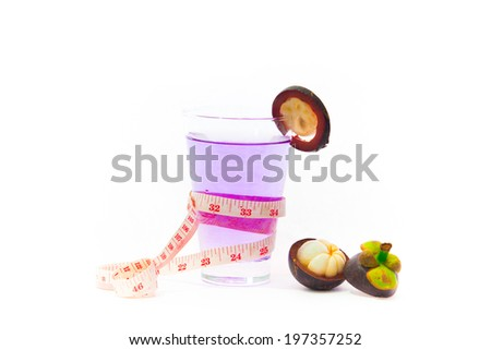 Healthy mangosteen juice with tape measure on a white background. - stock photo