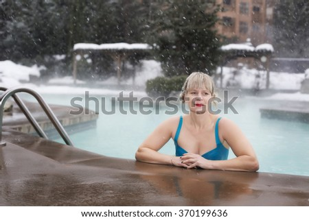 healthy mature woman at pool in snow - stock photo