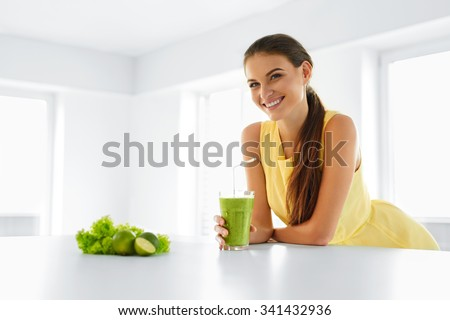 Healthy Meal. Happy Beautiful Smiling Woman Drinking Green Detox Vegetable Smoothie. Healthy Lifestyle, Food And Eating. Drink Juice. Diet, Health And Beauty Concept. - stock photo