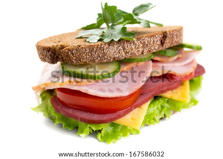 Healthy Meat, Cheese and Vegetables Sandwich on Whole Wheat Bread - stock photo