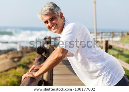 healthy middle aged man workout at the beach in the morning - stock photo