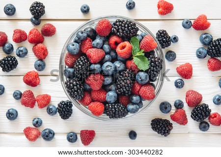 Healthy mixed fruit and ingredients with strawberry, raspberry, blueberry, blackberry from top view - stock photo