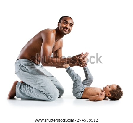 Healthy morning stretching - man with son doing gymnastic exercise / photo set of sporty muscular Hispanic shirtless fitness man with his son over white background - stock photo