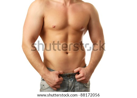 Healthy muscular man posing over white background