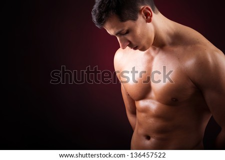 Healthy muscular young man with beautiful six pack - stock photo