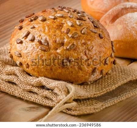 Healthy natural bread on a  wooden table . Selective focus - stock photo