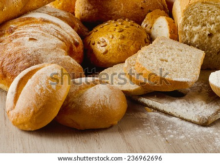 healthy natural bread on  wooden background. Selective focus - stock photo