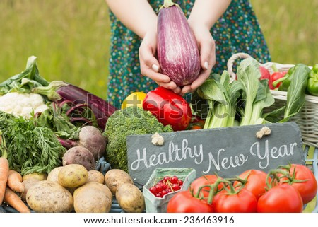 Healthy New Year against vegetables at farmers market - stock photo