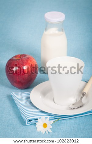 Healthy nutrition with fresh milk and a red apple