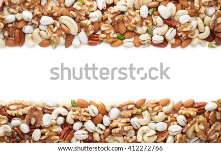 Healthy nuts over white background with copy space  - stock photo