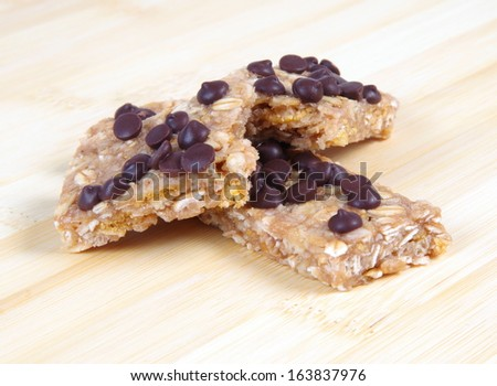 healthy oat bar with chocolate chips on table - stock photo