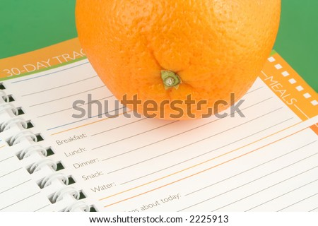 healthy orange and diet and nutrition journal - stock photo