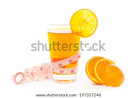 Healthy orange juice with tape measure on a white background.