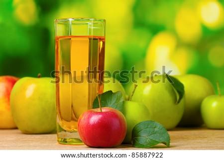 Healthy organic apple juice on table - stock photo