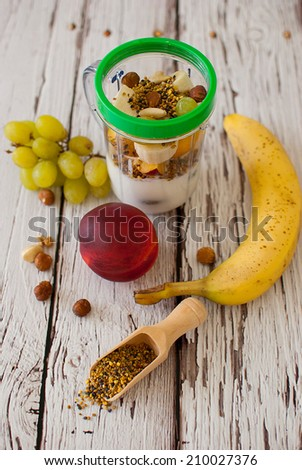 healthy organic fruit and nuts smoothie on wooden board