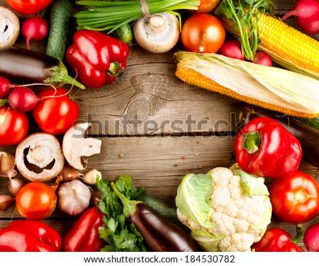 Healthy Organic Vegetables on a Wooden Background. Wood. Bio vegan food. Art Frame Design  - stock photo