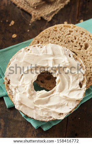 Healthy Organic Whole Grain Bagel with Cream Cheese - stock photo