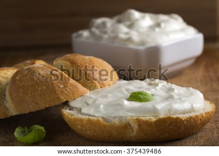 Healthy Organic Whole Grain Bagel with Cream Cheese over wooden background - stock photo