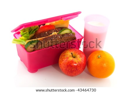 Healthy pink lunch box filled with bread for take away - stock photo