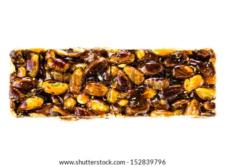 Healthy pistachio nut bar isolated on white background. Fitness style lifestyle concept. Healthy snack. - stock photo