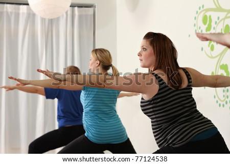 Healthy prenatal lifestyle, yoga class - stock photo