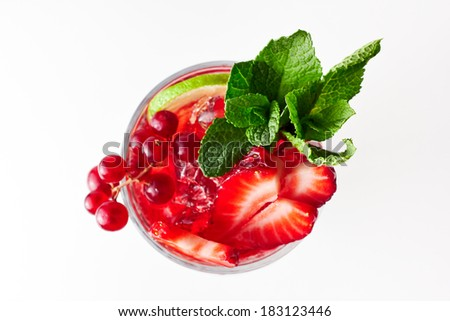 Healthy red berry cocktail with mint garnish. On white background. Top view. Berries are redcurrant, strawberry and cherry.  - stock photo