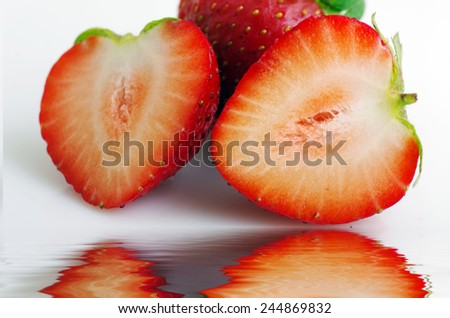Healthy red strawberry fruit sliced isolated on the white background  - stock photo