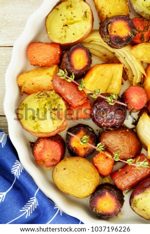 Healthy roasted root vegetables from overhead in vertical format and shot in natural light