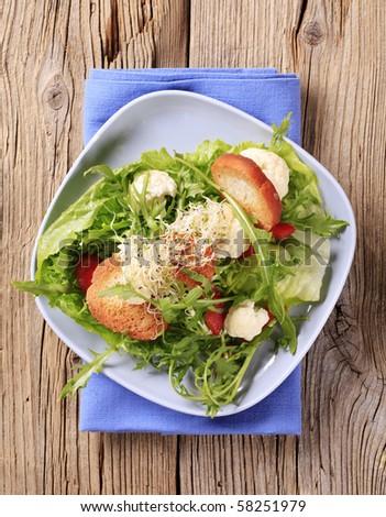 Healthy salad and crispy bread - stock photo