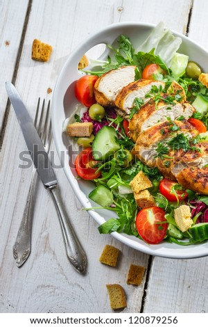 Healthy salad made of fresh vegetables - stock photo
