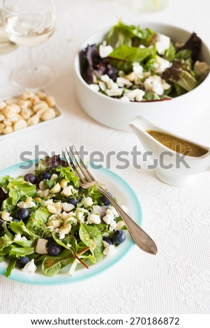 Healthy salad with blue berries and goat cheese