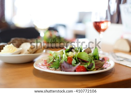 Healthy salad with bread in restaurant
