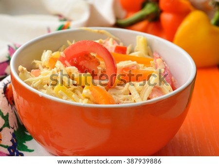 healthy salad with celery root, sweet pepper, tomatoes