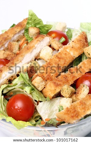 Healthy salad with chicken and vegetables in bowl