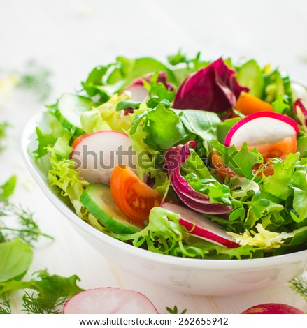 Healthy salad with fresh vegetables on white background, square image - stock photo