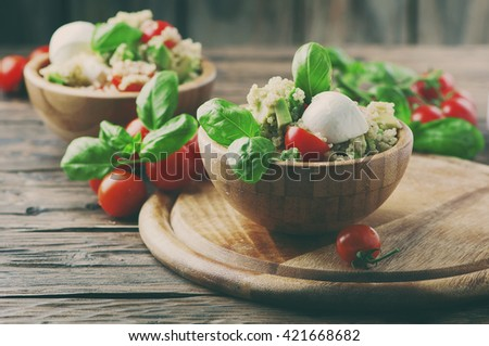 Healthy salad with quinoa, tomato and avocado, selective focus and toned image - stock photo