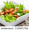 Healthy salad with roasted chicken, tomatoes and feta - stock photo