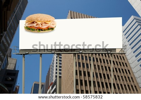 Healthy sandwich on a blank white billboard office building on background - stock photo