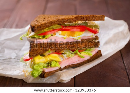 Healthy sandwich on wood background