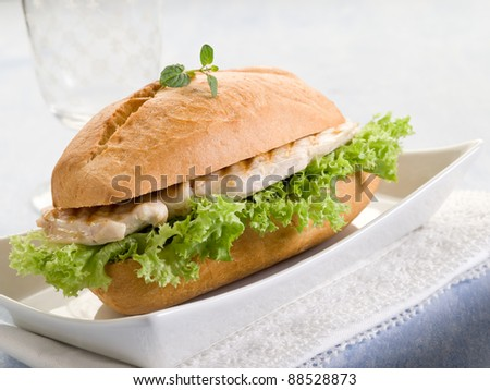 healthy sandwich with chest of grilled chicken and lettuce - stock photo