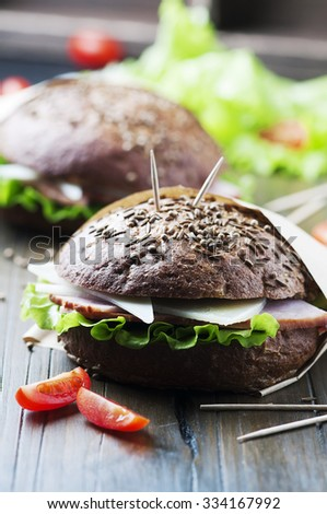 Healthy sandwich with ham, cheese and lettuce, selective focus