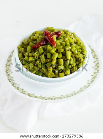 Healthy Sauteed Green Beans  Cooked Green beans ready to be served as a Salad or a Side Dish isolated on a White Background  - stock photo